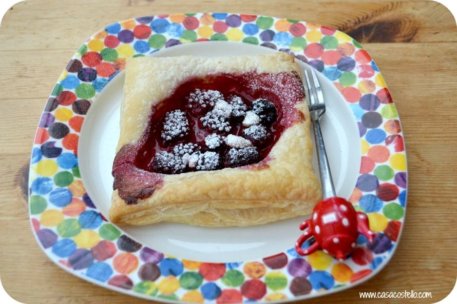 blackberry puff pastry squares with marzipan shavings