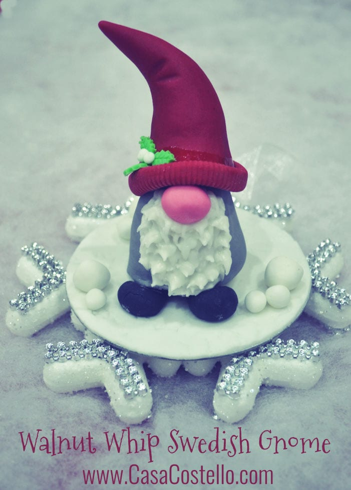 Small Edible Walnut Whip Swedish Gnome sat on a snowflake