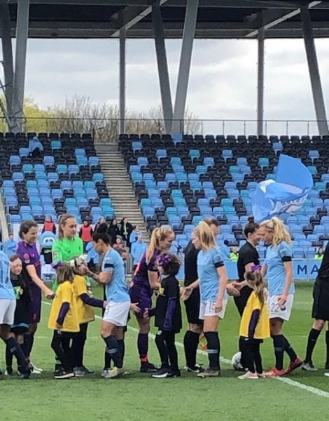 Little girls being football mascots Man City 2019
