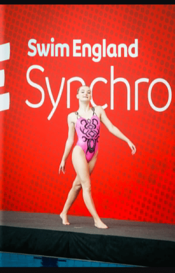 Synchronised swimmer walking onto the deck